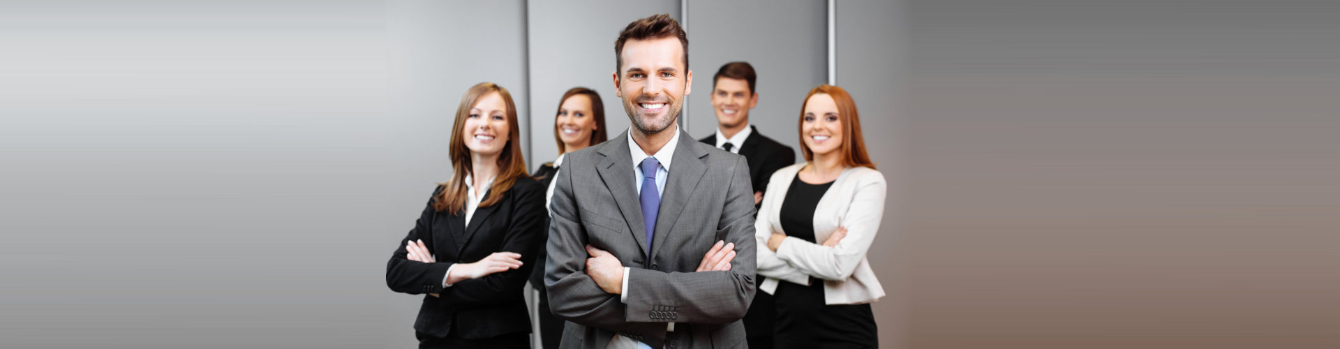 a group of consultants smiling